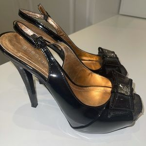 Black BCBGeneration sling back heels with bows